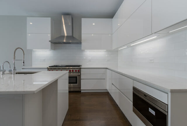 Modern kitchen with flat white Italian cabinets and white Chinese quartz in gut renovated single family home in Lincoln Park showing 3F general contracting capabilities