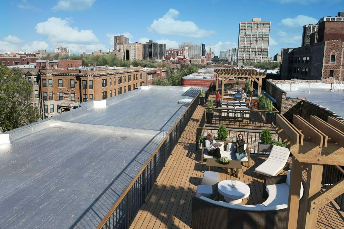 Roof top deck with wood trellis and outdoor furniture and plantings