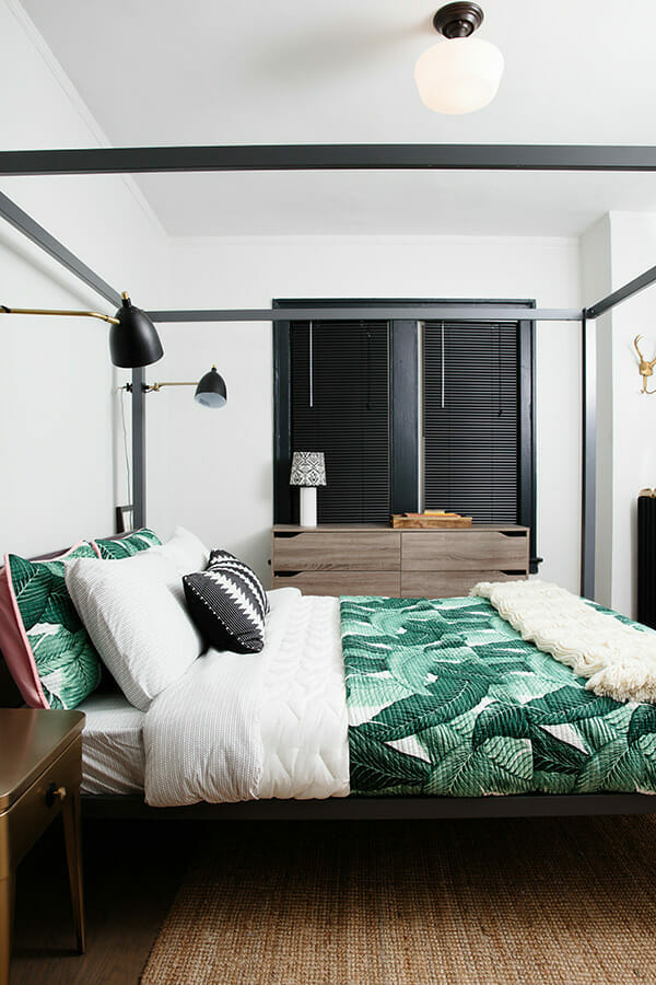 Renovated apartment bedroom with 4 post bed