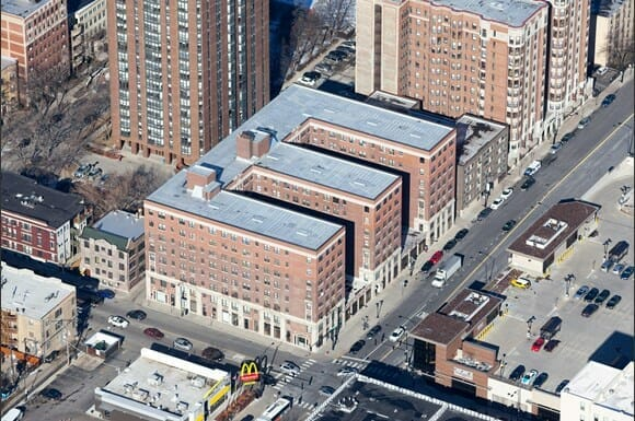 Aerial view of the exterior of The Edison with a red brick facade and limestone accents.