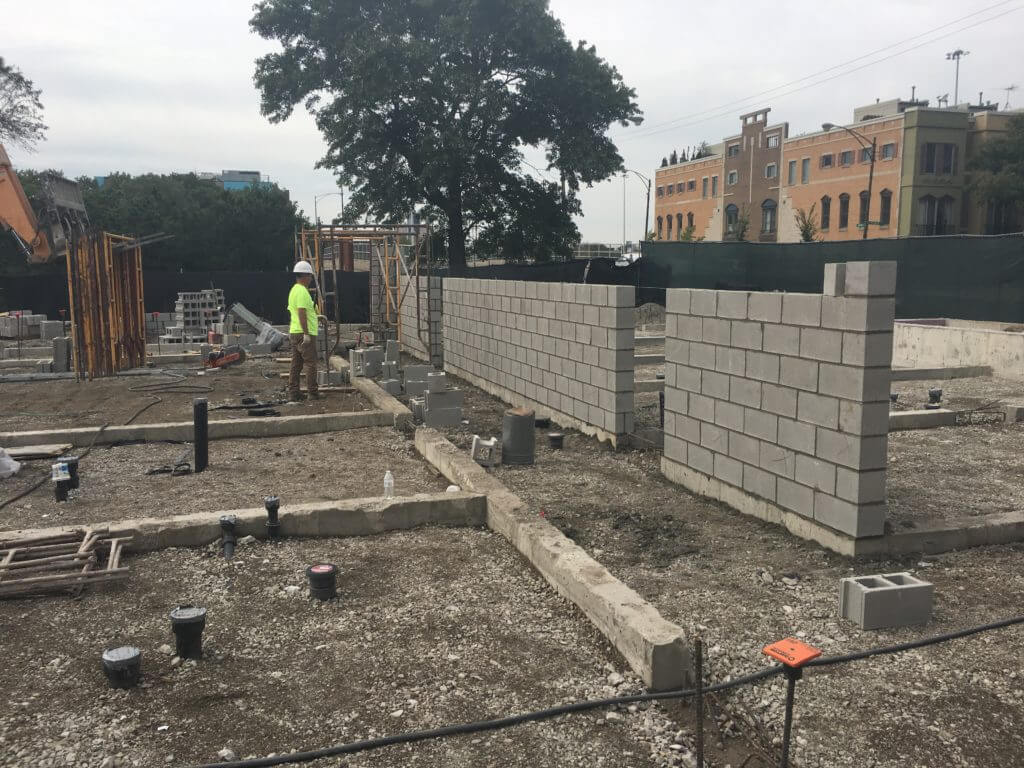 CMU shear wall and foundations for cold formed steel framed building